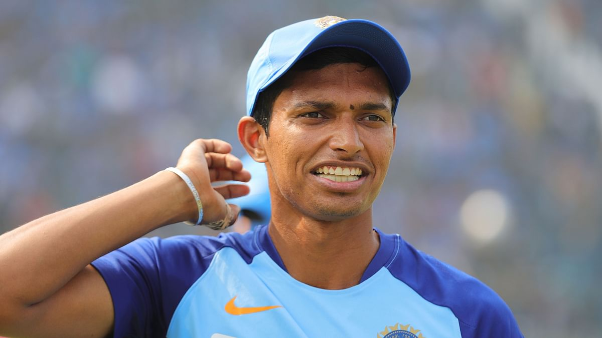 Navdeep Saini looks to have injured his groin and was taken off the field during the 36th over.