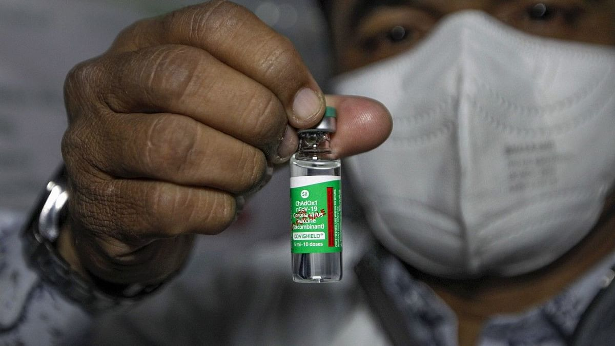 A health worker shows the 'Covishield' after the arrival of the first batch of the vaccines from the Serum Institute of India at the Civil Hospital in Ahmedabad.