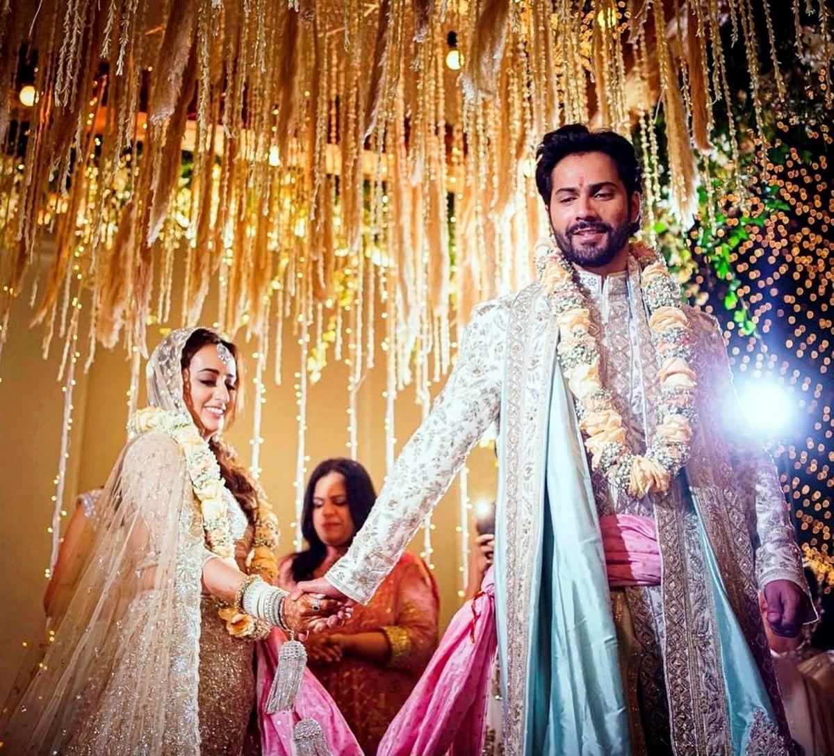 Bollywood actor Varun Dhawan and Natasha Dalal during their wedding ceremony at Alibaug in Mumbai, Sunday, 24 January 2021.