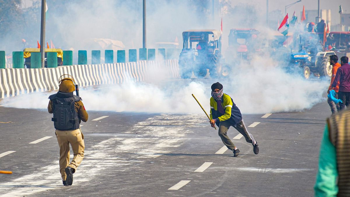 Police fires teargas shells as farmers attempt to march towards Delhi during the Kisan Gantantra Parade amid the 72nd Republic Day celebrations, at Akshardham in New Delhi, Tuesday.