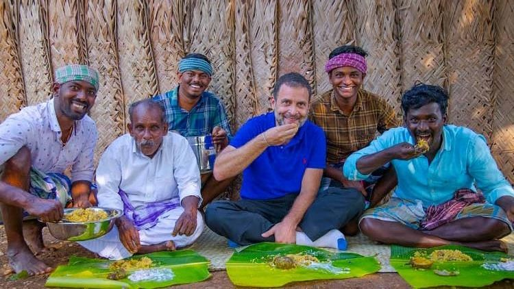 """Rahul Gandhi with people from the """"Village Cooking Show."""""""