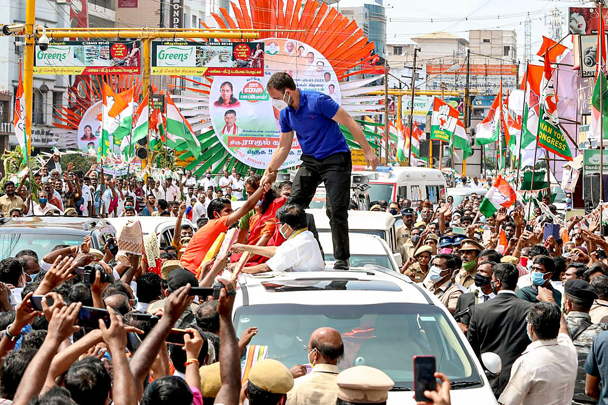 Congress leader Rahul Gandhi greets a young supporter during an election campaign rally ahead of Tamil Nadu assembly polls, in Karur district, Monday, 25 January 2021.