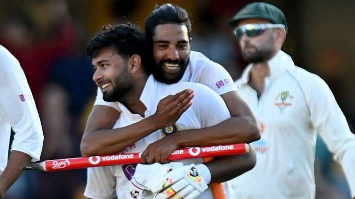 Rishabh Pant and Mohammed Siraj celebrate the Test series win against Australia.