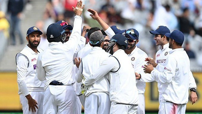 India celebrate a wicket at the MCG