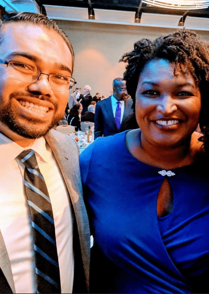 Sachin Varghese with Georgia Democrat Stacy Abrams (2018 picture).
