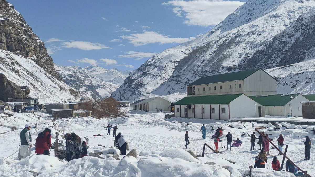 Tourists play in the snow near the Atal Tunnel, in Lahaul-Spiti. Image used for representation.
