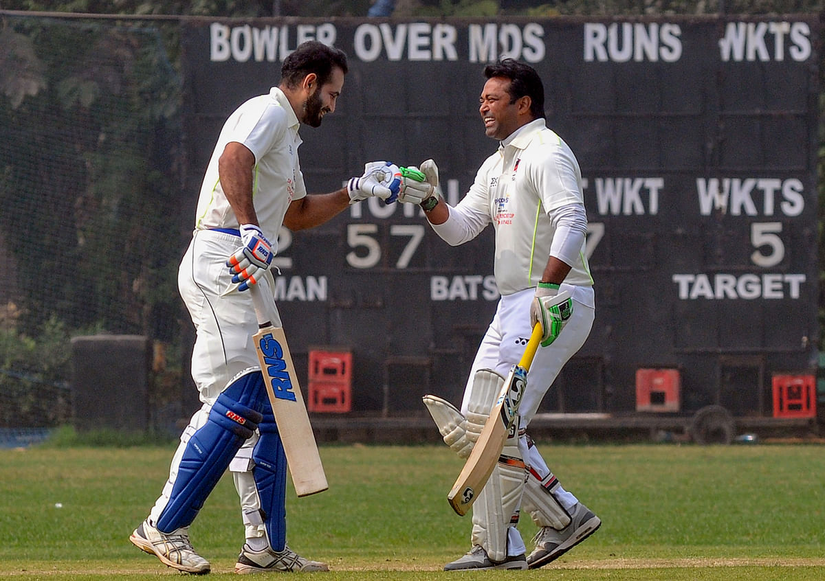 Former Indian cricketer Irfan Pathan and tennis player Leander Paes (R) greets each other during 'Dr Vece Paes Cricket Cup', in Kolkata, Tuesday, 26 January 2021.