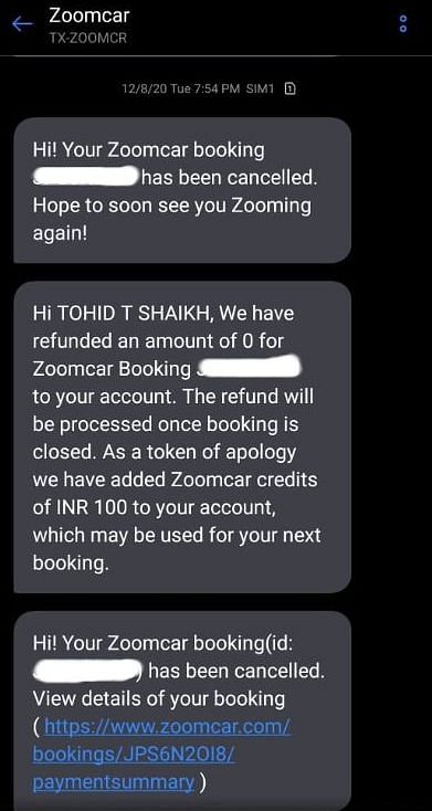 Booking cancellation message sent by Zoomcar on 8 December.