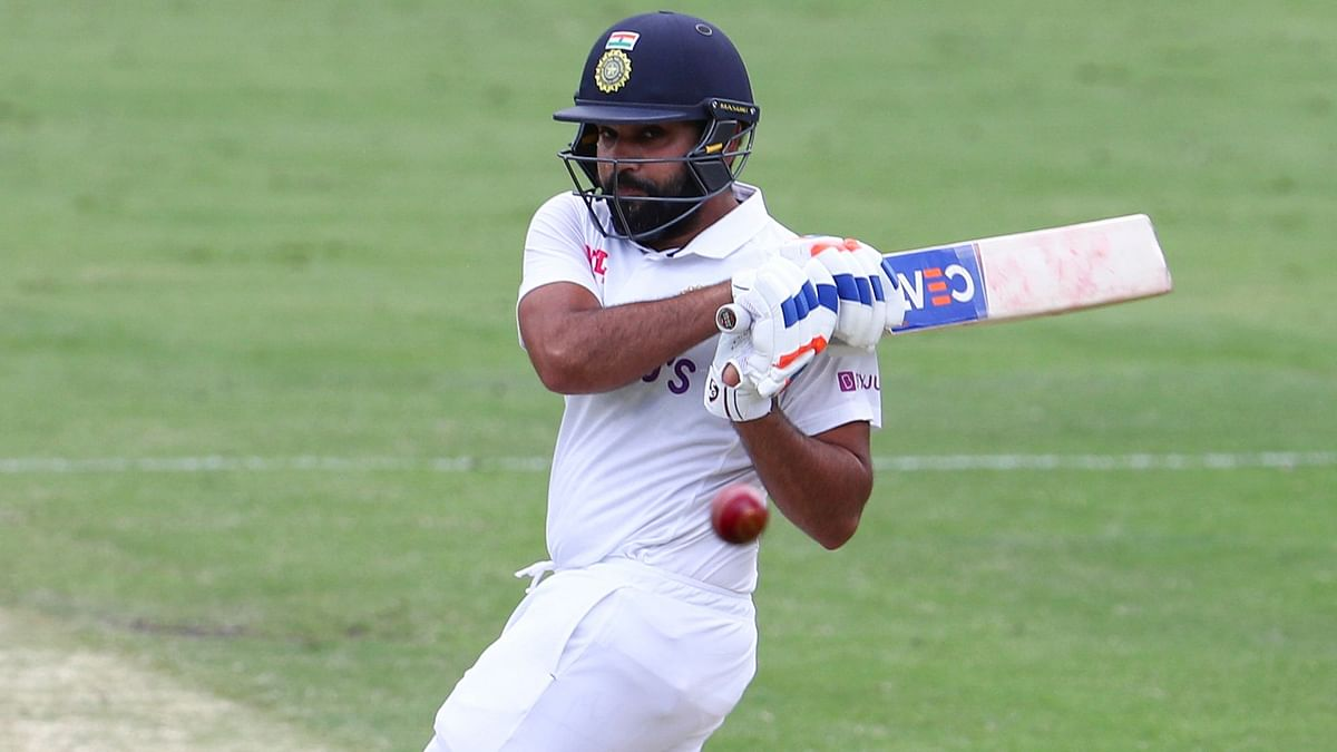 Rohit Sharma plays the pull shot to the fence during his 44 at the Gabba.