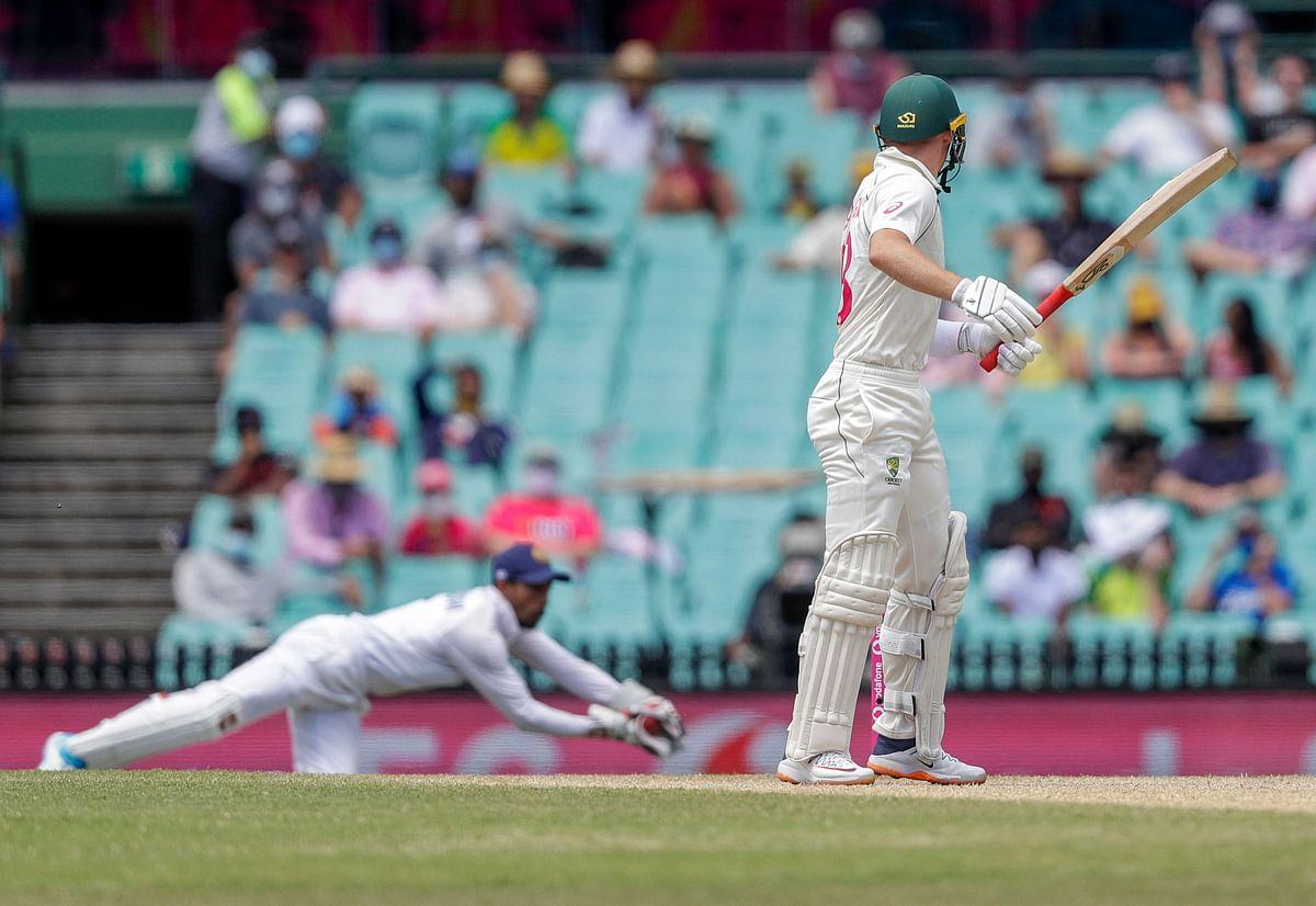 Indian wicketkeeper Wriddhiman Saha takes the catch to dismiss Australia's Marnus Labuschagne.