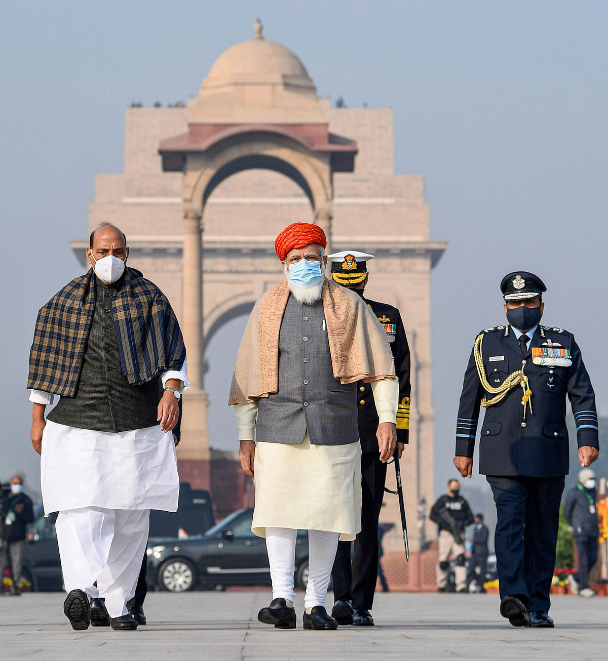 Prime Minister Narendra Modi and Defence Minister Rajnath Singh arrive at the National War Memorial, on the occasion of the 72nd Republic Day Parade 2021, in New Delhi, Tuesday, 26 January 2021.