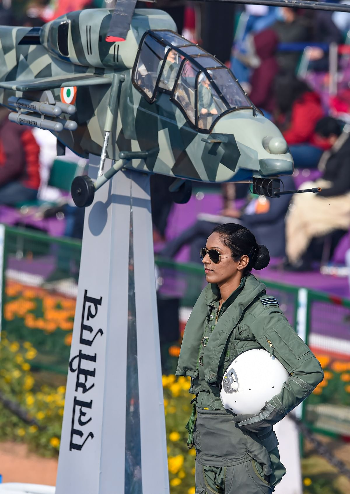 Flight lieutenant Bhawana Kanth stands on the Indian Air Force (IAF) tableau as it moves past Rajpath, during the 72nd Republic Day celebrations in New Delhi, Tuesday, 26 January 2021. Kanth became the first woman fighter pilot to take part in the January 26 ceremonial event.
