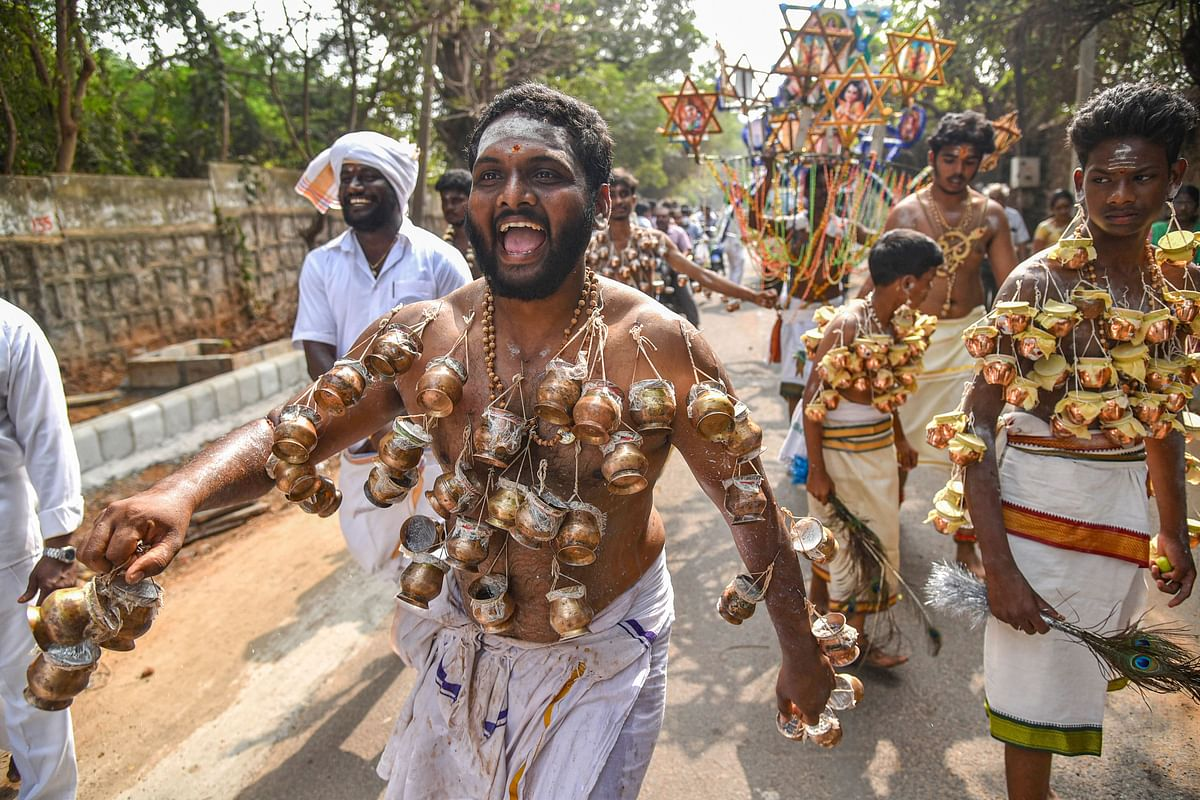 A Hindu devotee with his body pierced with pots takes part in a procession in connection with the Thaipusam festival, in Visakhapatnam, Thursday, 28 January 2021.