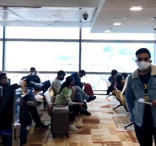 UK passengers waiting at the Airport Lounge.