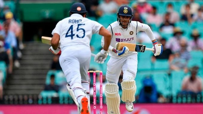 India's Rohit Sharma and Shubman Gill steal a single during the first innings at the SCG against Australia.