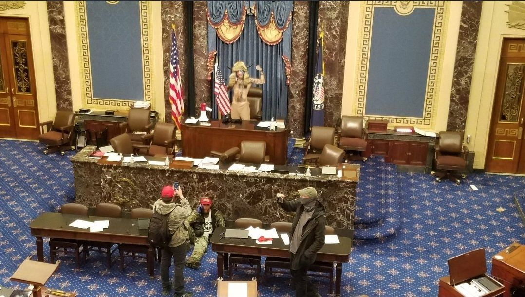 Visuals show Trump supporters marching through Statuary Hall, some even sitting on the Speaker's seat.