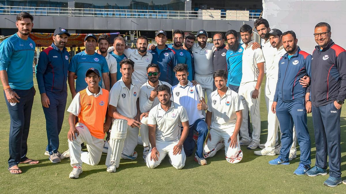 Players and officials of Jammu and Kashmir Ranji team pose for a photograph after winning the match against Assam in Guwahati on 1 January 2019.