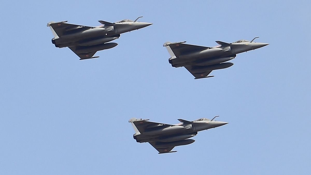 Indian Air Force's Rafale aircrafts fly in a formation over Yelahanka air base during the inauguration of the 13th edition of Aero India, in Bengaluru, Wednesday, 3 February 2021.