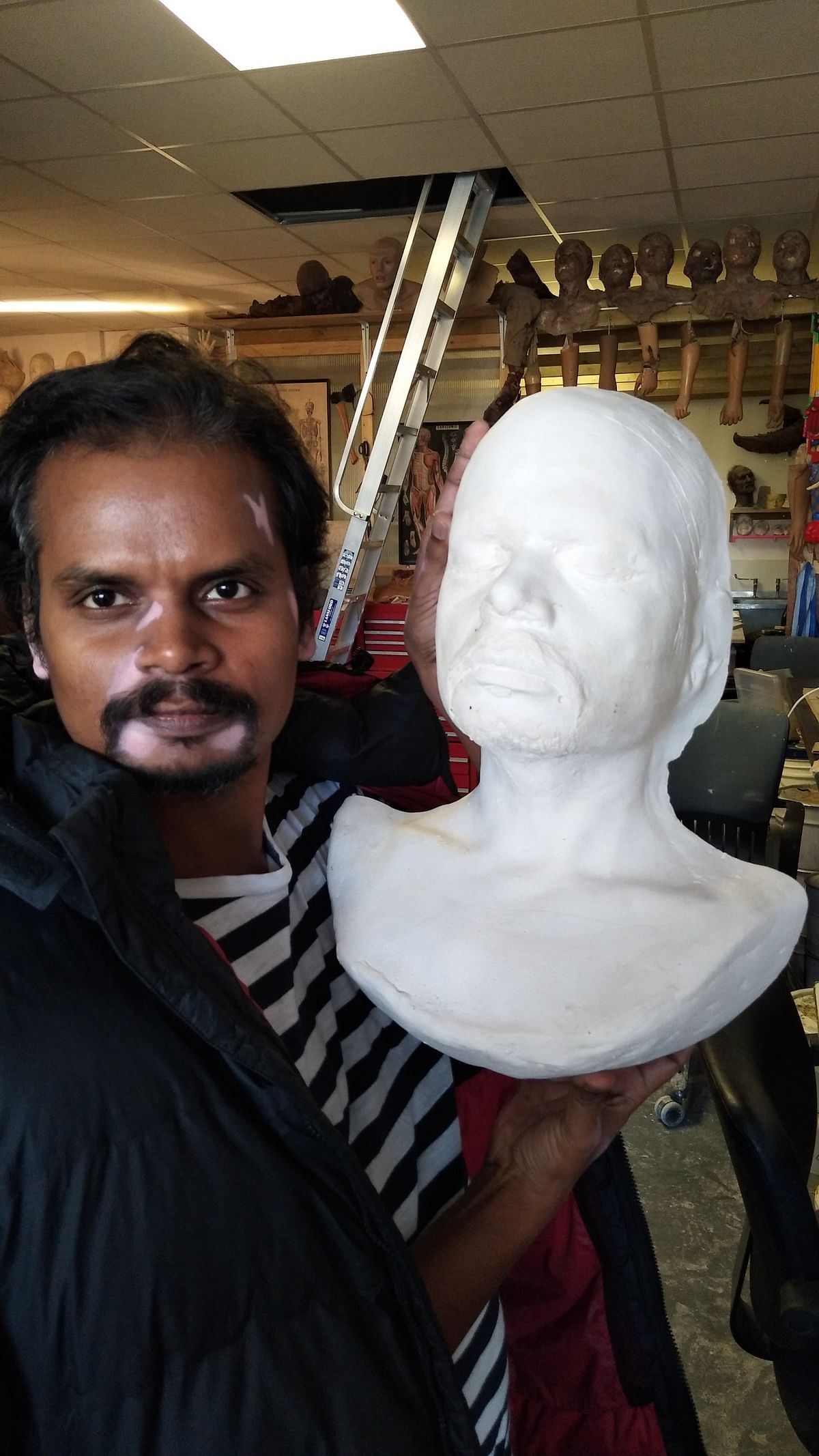 <p>Nalneesh holding the lifecast of his face.</p>