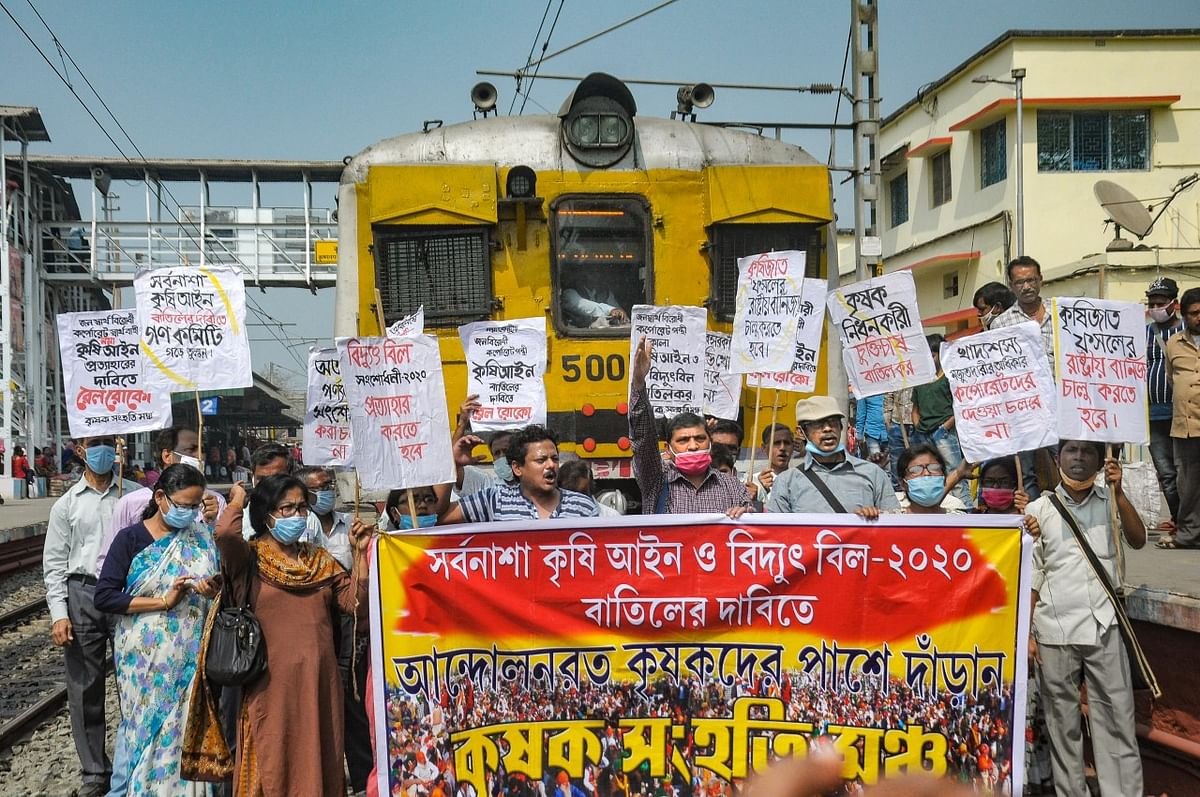 Members of various farmer organisations block a railway track during a four-hour rail roko demonstration across the country, called by Samyukta Kisan Morcha (SKM), as part of their agitation against Centre's farm reform laws, in Nadia district