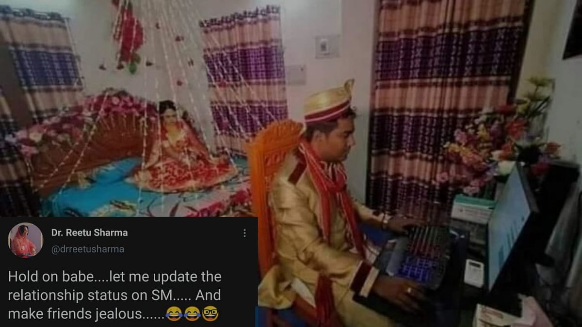 A photo of a groom glued to a computer screen as his wife waits has gone viral.
