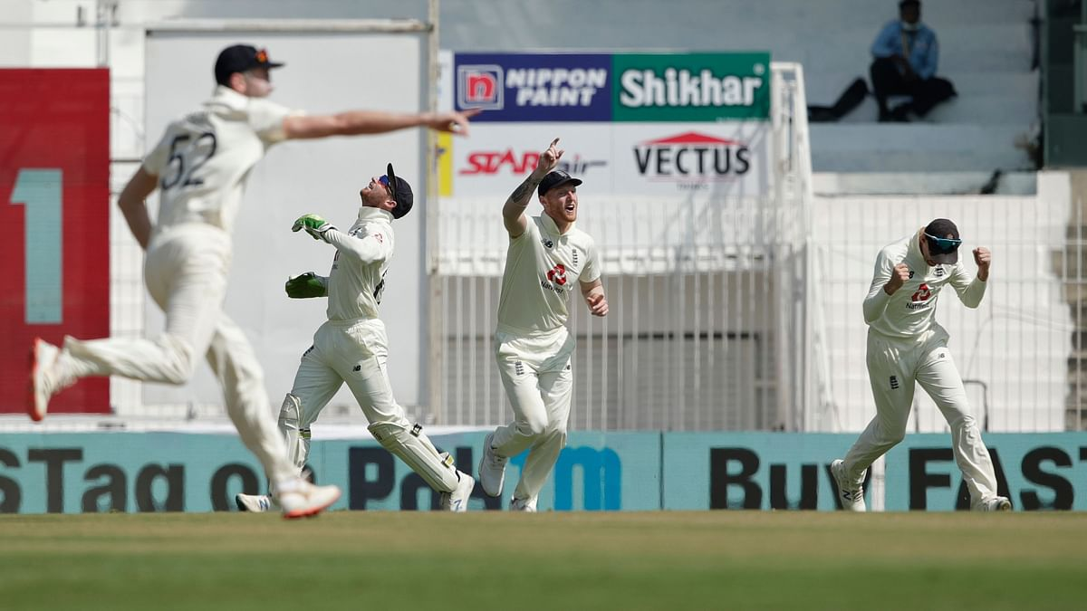 England  team celebrates the wicket of Rohit Sharma of India during day three of the first test match between India and England.