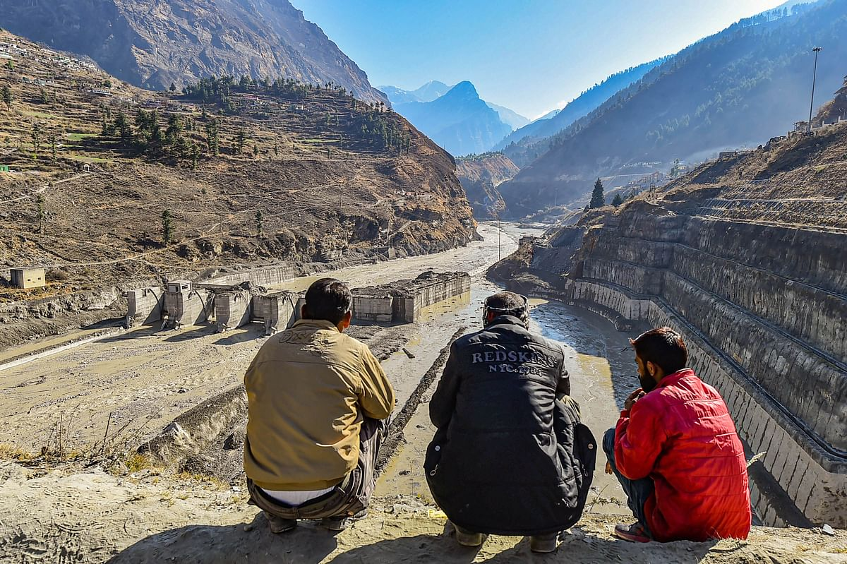 Villagers watch the rescue operations carried at Tapovan barrage, following Sunday's glacier burst in Joshimath causing a massive flood in the Dhauli Ganga river, in Chamoli district of Uttarakhand.