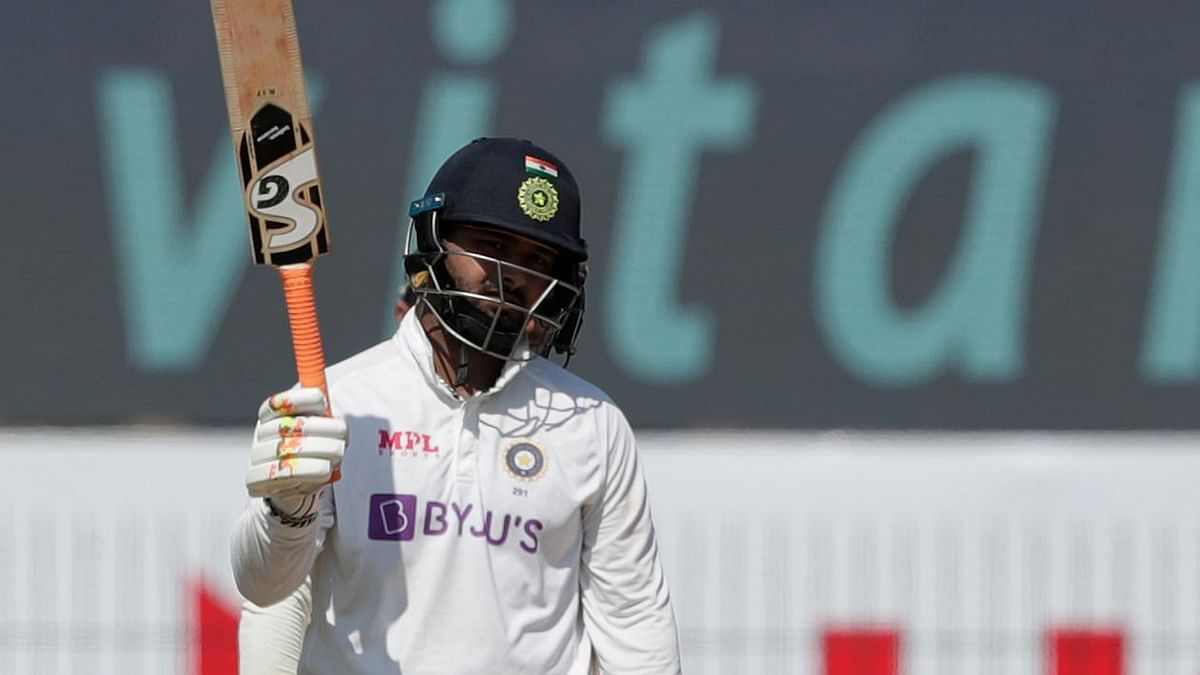 Rishabh Pant celebrates his half century on Day 3 of the Chennai Test. He went onto score 91 in the match.