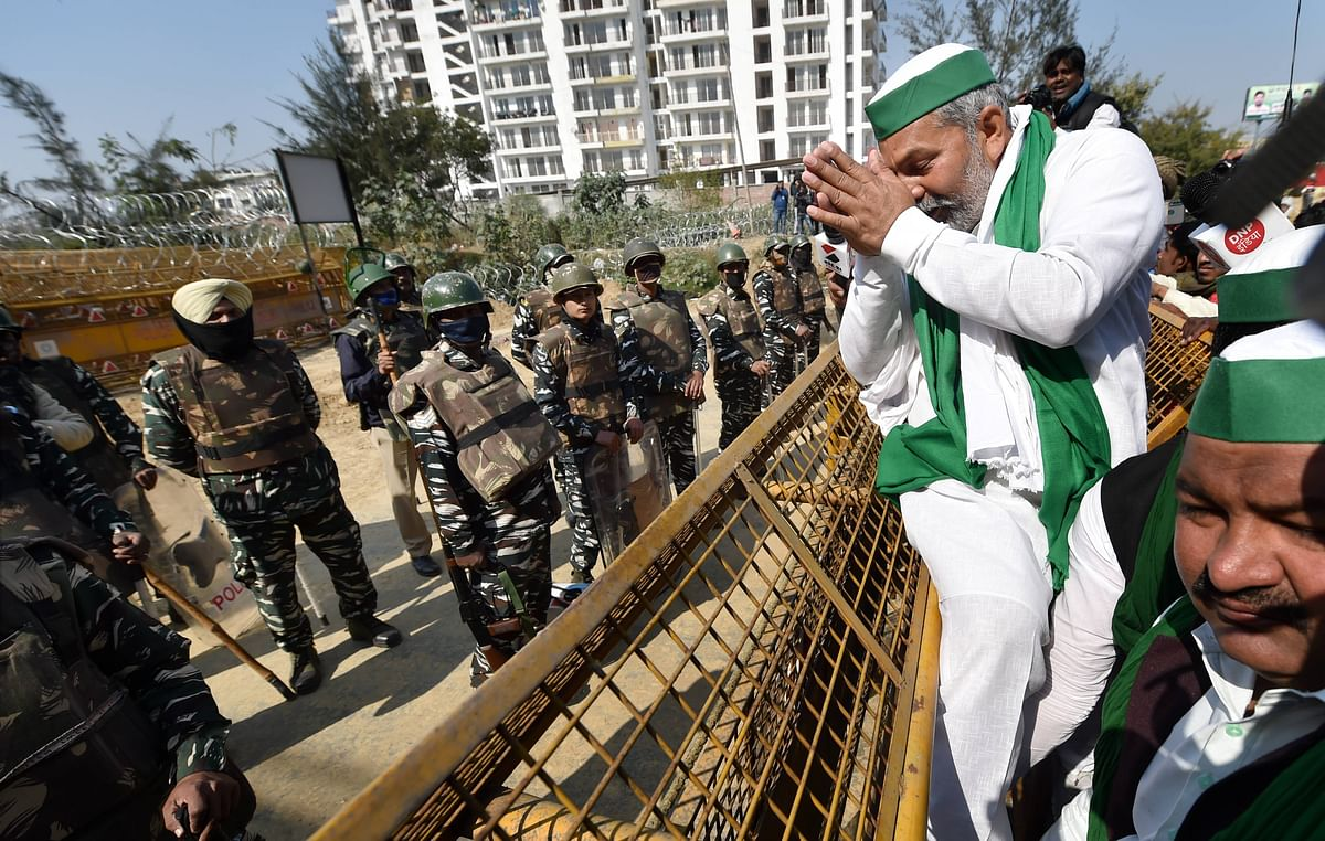 """<div class=""""paragraphs""""><p>(File photo): Security personnel stand near barricades as BKU spokesperson Rakesh Tikait gestures during the proposed chakka jam by farmers at Ghazipur border.</p></div>"""