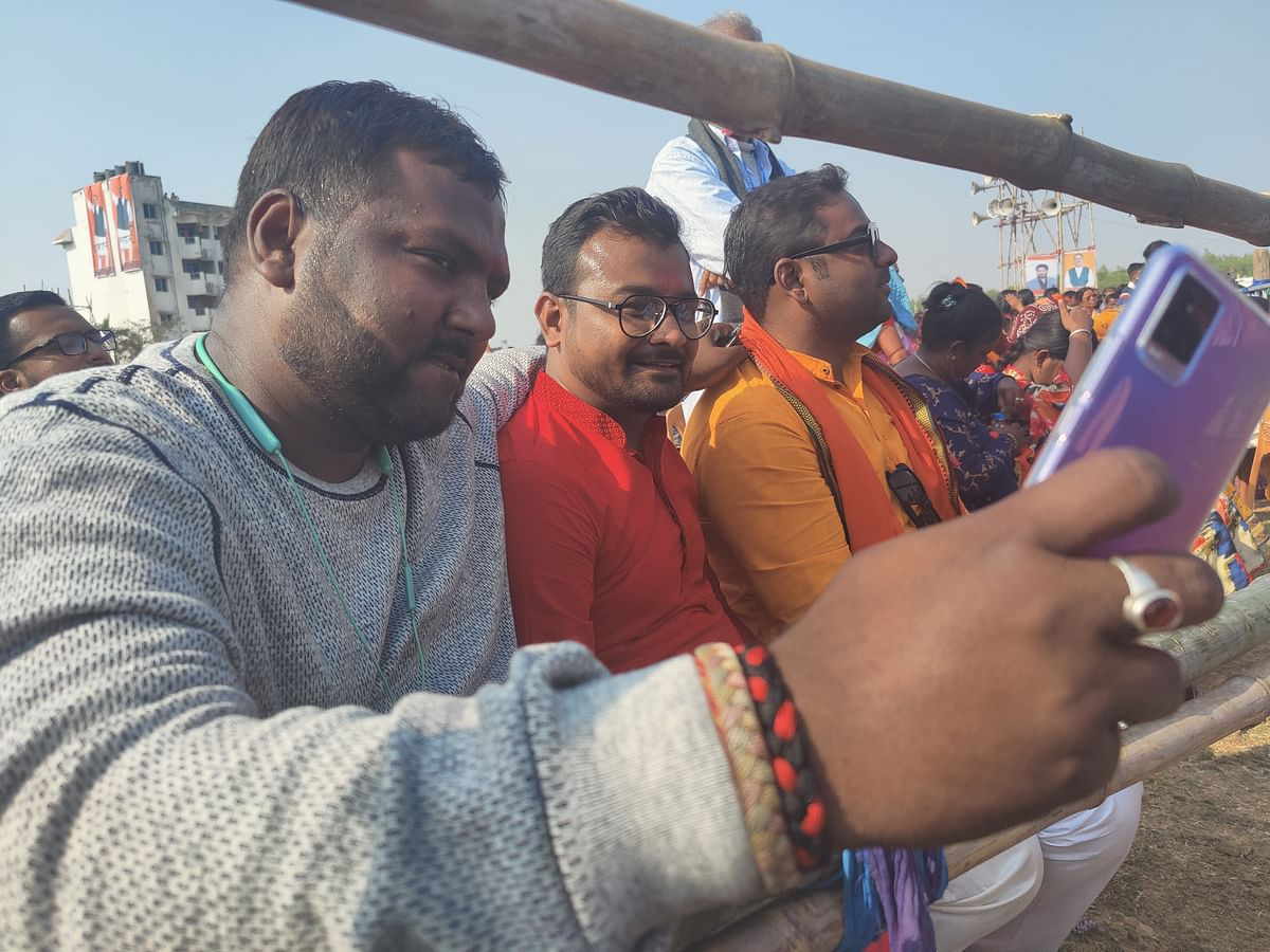 Sudip Prasad (grey shirt) takes a selfie with the other supporters of Krishna Prasad.
