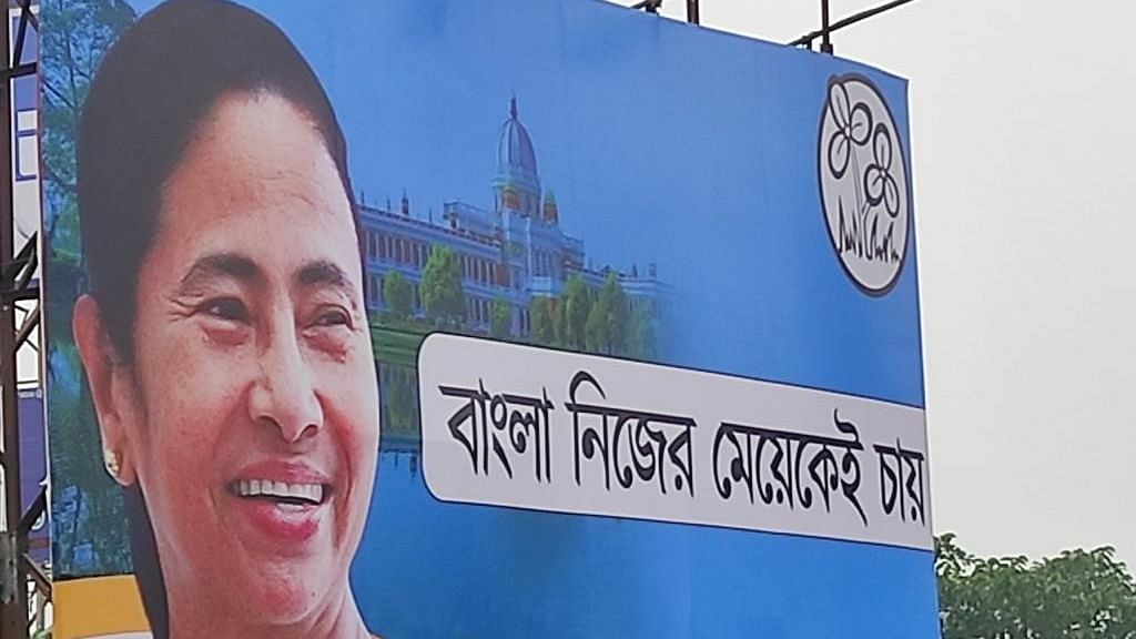 "<p>The Trinamool Congress (TMC) launched its main ""campaign slogan"" for the upcoming West Bengal elections in a much-publicized event on 20 February.</p> <p>The new slogan- <em>Bangla Nijer Meyekei Chaaye</em>- Bengal Wants Its Own Daughter - was plastered on hoardings across Kolkata the night before.</p>"