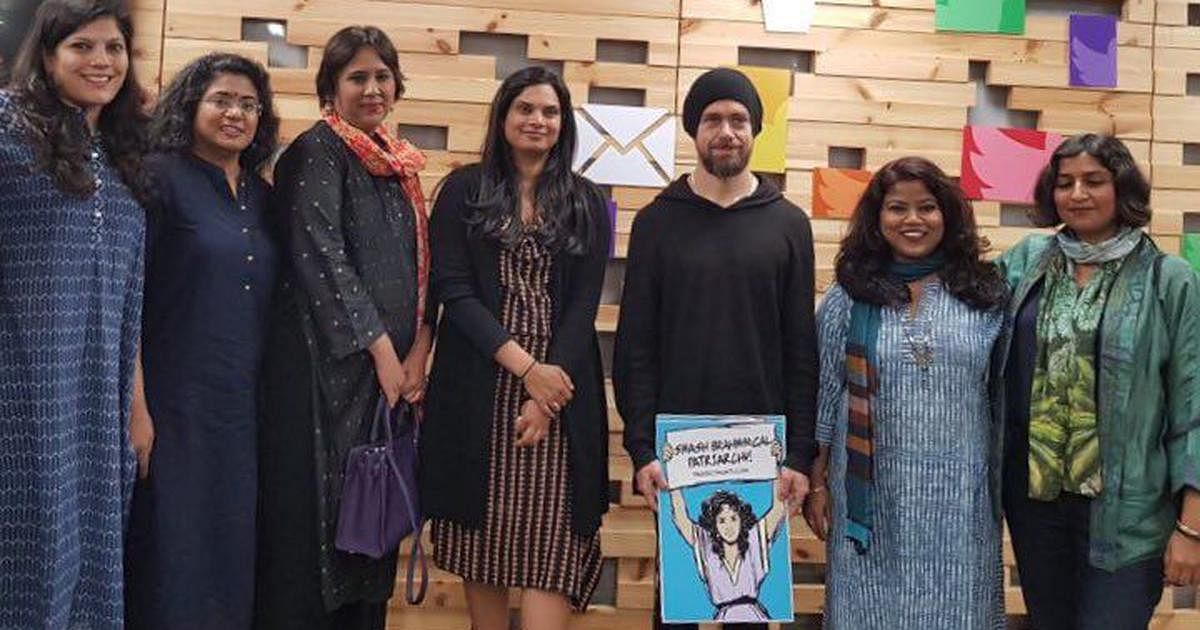 Twitter CEO Jack Dorsey holding a poster that reads 'Smash Brahminical Patriarchy'