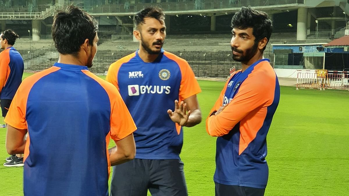 Axar Patel and Jasprit Bumrah in conversation during India's training session in Chennai.