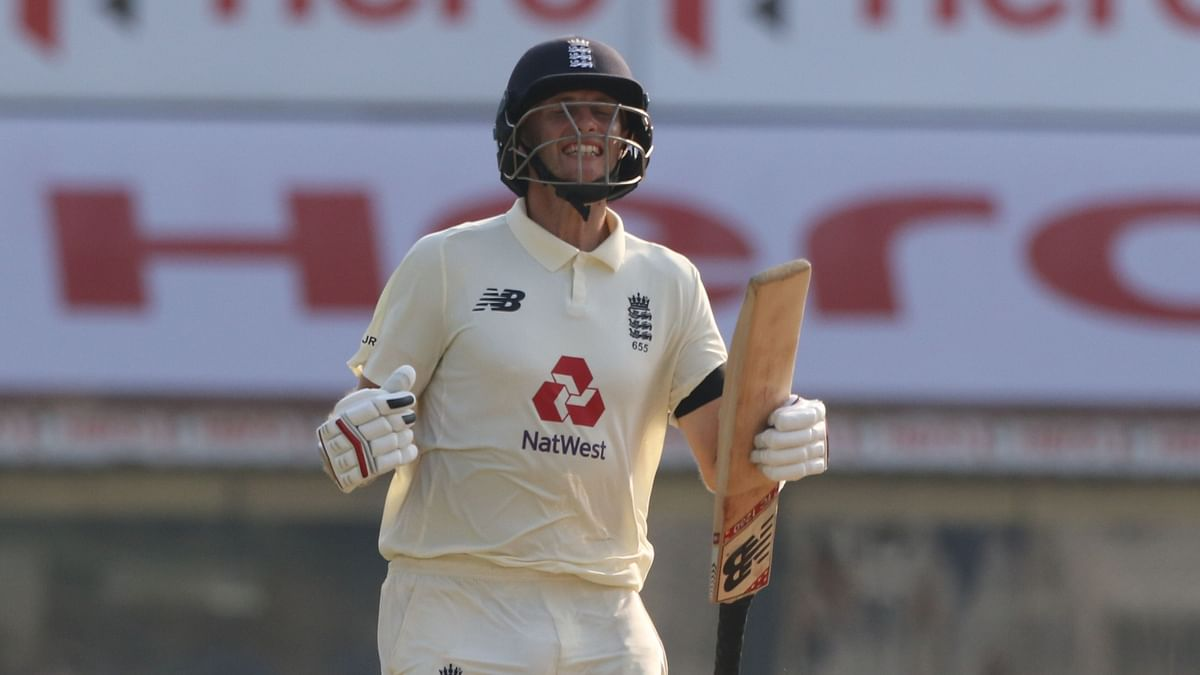Joe Root celebrates his century against India in his 100th Test.