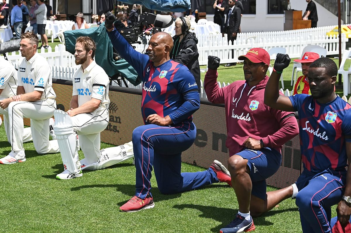 The West Indies and New Zealand teams take a knee for the Black Lives Matter movement ahead of a Test match in New Zealand on 3 December, 2020.