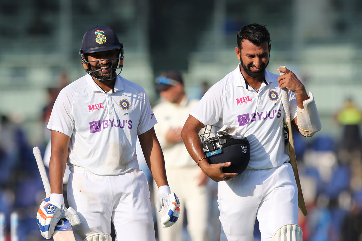 Rohit Sharma and Cheteshwar Pujara walk back to the pavilion at the end day two of the Chennai Test.