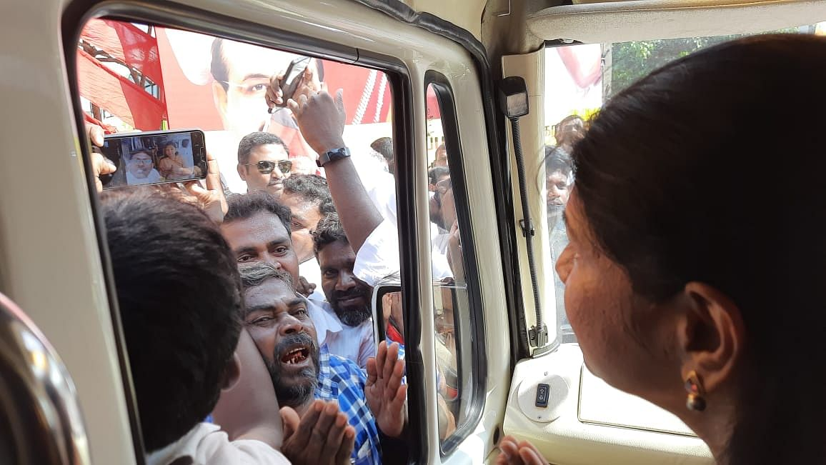 A DMK supporter breaks down in excitement looking at Kanimozhi.