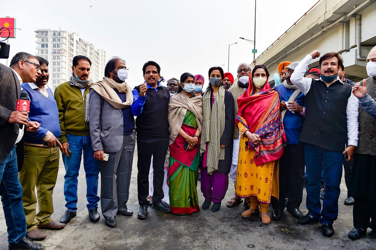 Shiromani Akali Dal leader Harsimrat Kaur Badal, Nationalist Congress Party (NCP) leader Supriya Sule, Dravida Munnetra Kazhagam (DMK) leader Kanimozhi Karunanidhi and other Opposition leaders during their visit to Ghazipur border, in solidarity with farmers' agitation against Centre's farm reform laws.