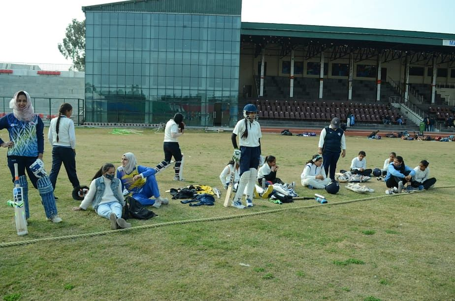 Young players on the sidelines of the Nari Shakti Cricket Pratiyogita in Jammu.