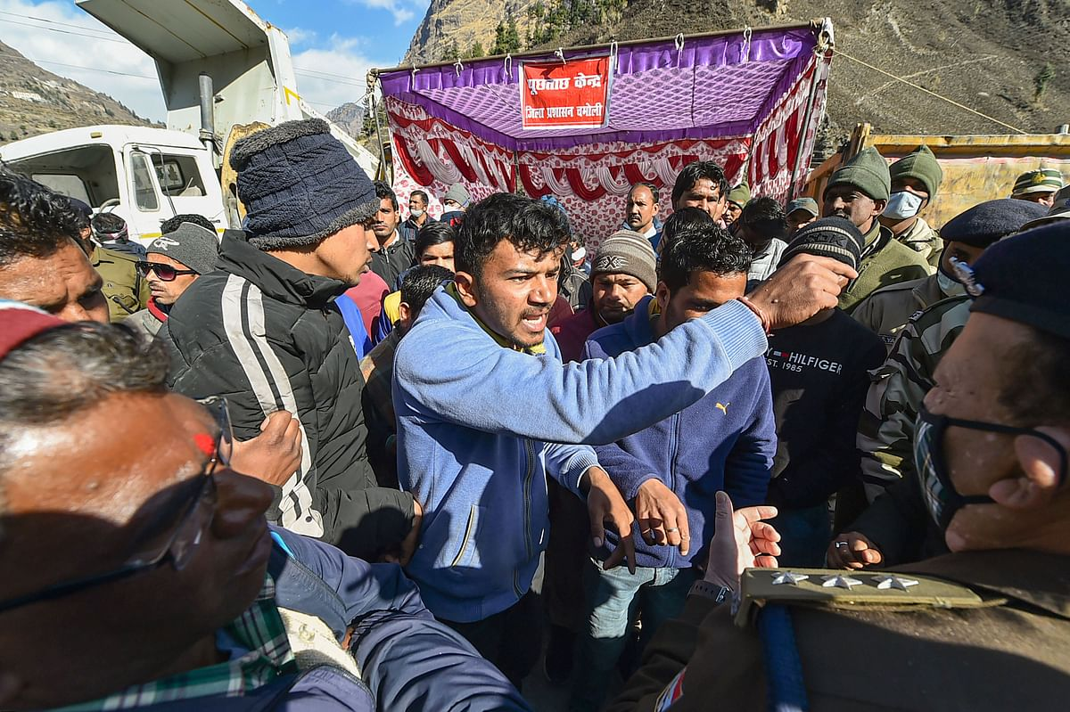 Family members and relatives of missing people get in a verbal spat with officials at a makeshift enquiry centre, near Tapovan Tunnel in Chamoli district of Uttarakhand.