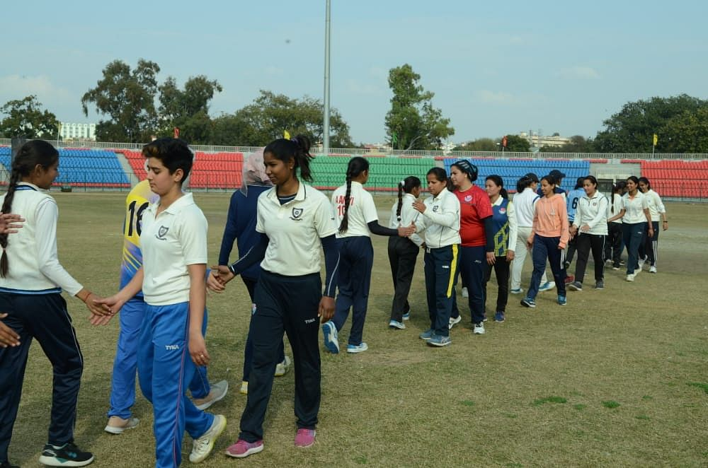 Young players shake hands after the completion of a match in the Nari Shakti Cricket Pratiyogita in Jammu.