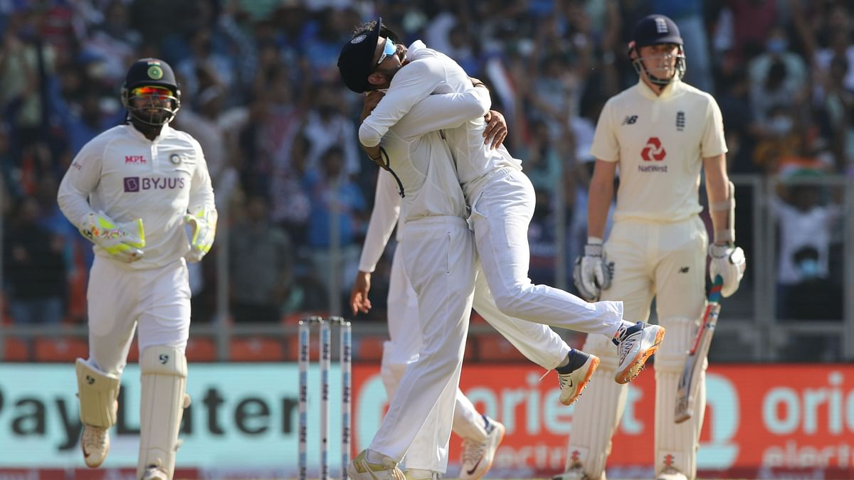 Axar Patel and Virat Kohli celebrate the wicket of Zak Crawley.
