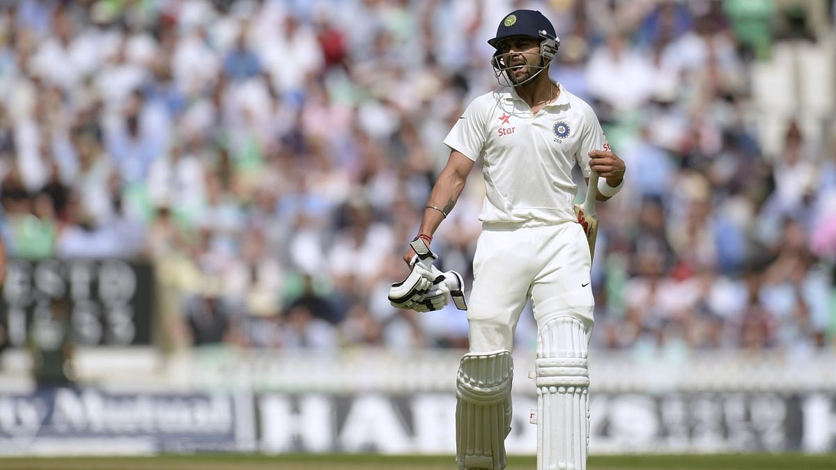 India's Virat Kohli leaves the field after being dismissed during the fifth Test against England at the Oval in 2014.