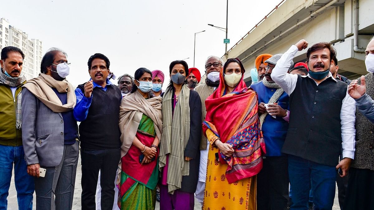 Shiromani Akali Dal leader Harsimrat Kaur Badal, Nationalist Congress Party (NCP) leader Supriya Sule, Dravida Munnetra Kazhagam (DMK) leader Kanimozhi Karunanidhi and other opposition leaders during their visit to Ghazipur border, in solidarity with farmers' agitation against the Centre's farm reform laws.