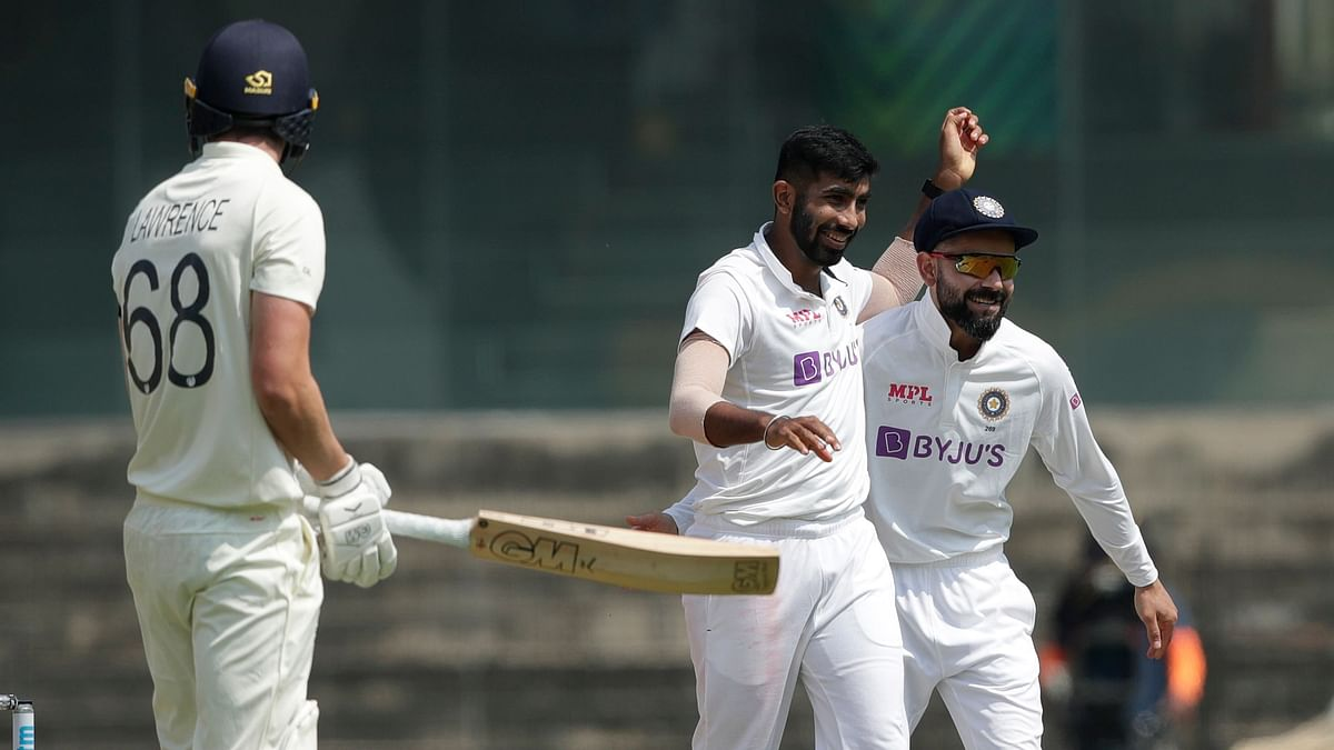 Virat Kohli(Captain) of India celebrates the wicket of Dan Lawrence of England with Jasprit Bumrah of India during day one of the first test match between India and England held at the Chidambaram Stadium stadium in Chennai.