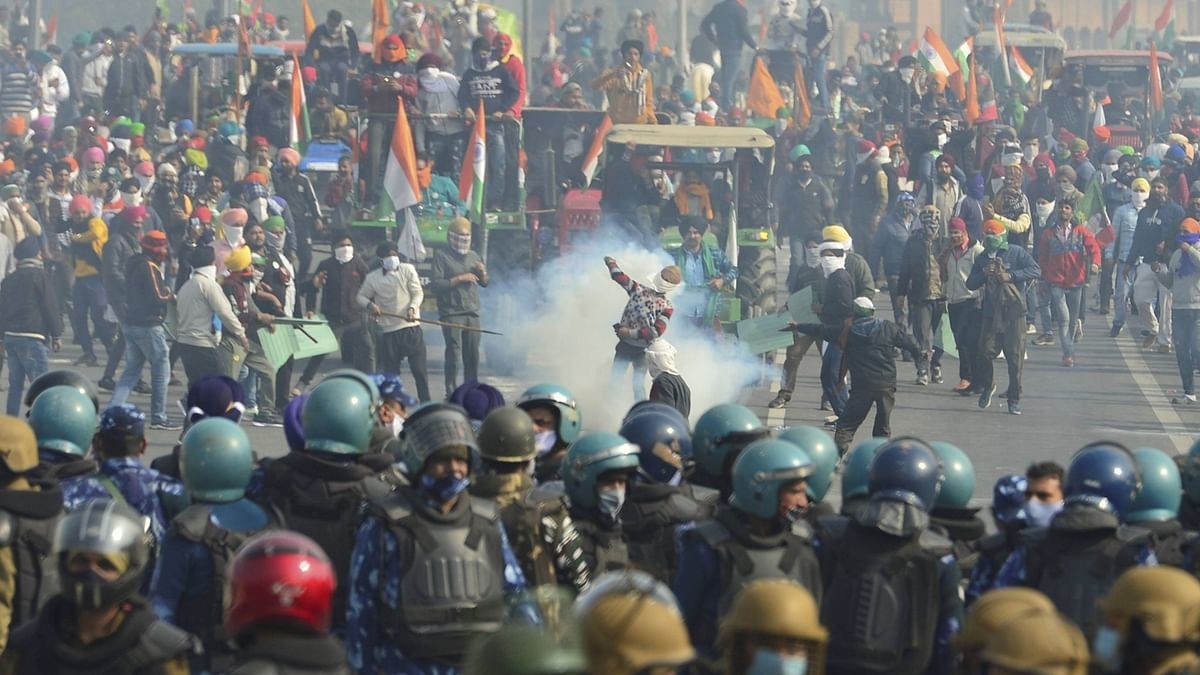 Police uses tear gas to disperse farmers attempting to break barricades at Ghazipur border during their 'Kisan Gantantra Parade', on the occasion of 72nd Republic Day.