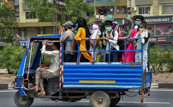 Migrant workers in Surat board a mini-truck to return to their villages on 26 March 2020.