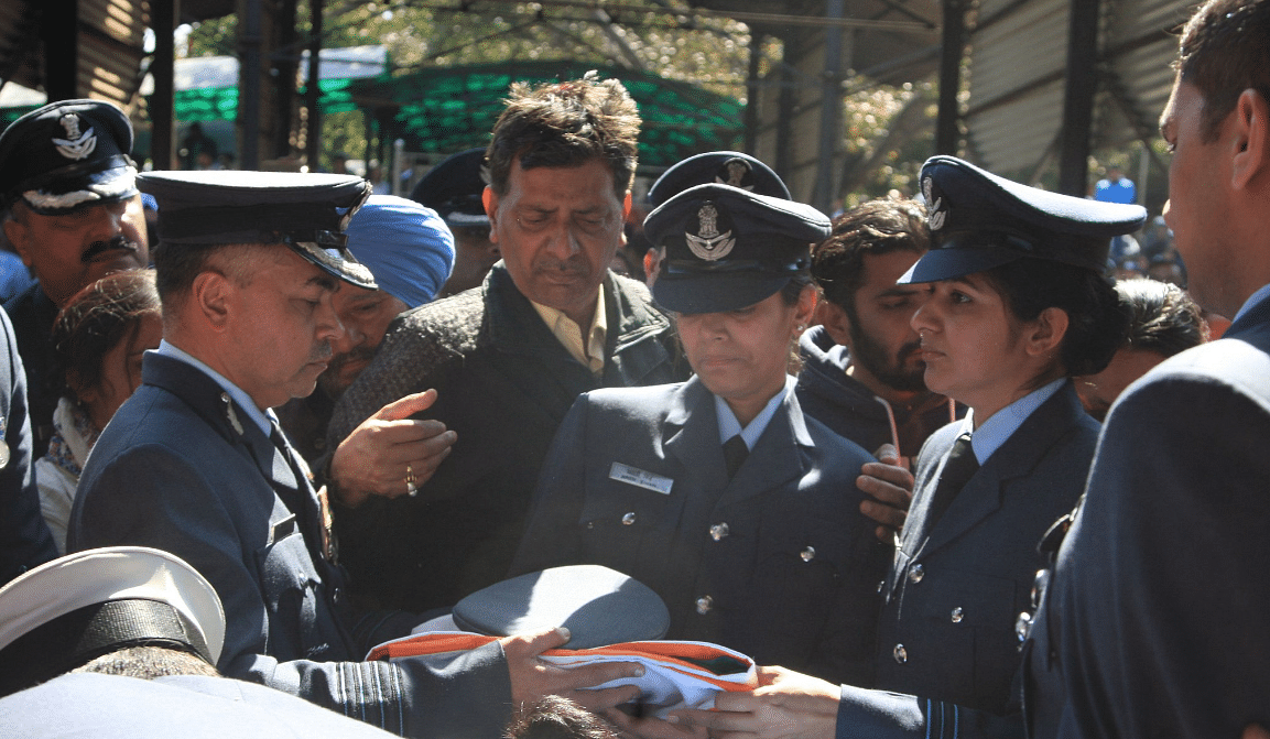 In uniform, the deceased officer's wife, Aarti Singh (second from left).