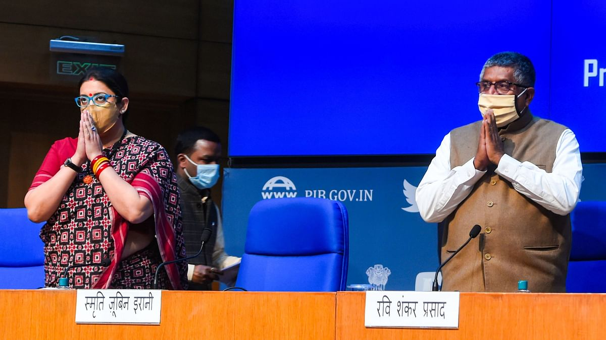 Union Law Minister Ravi Shankar Prasad and Minister of Textiles and Women and Child Development Smriti Irani (L) during a press conference on cabinet decisions, in New Delhi, Wednesday, 17 February