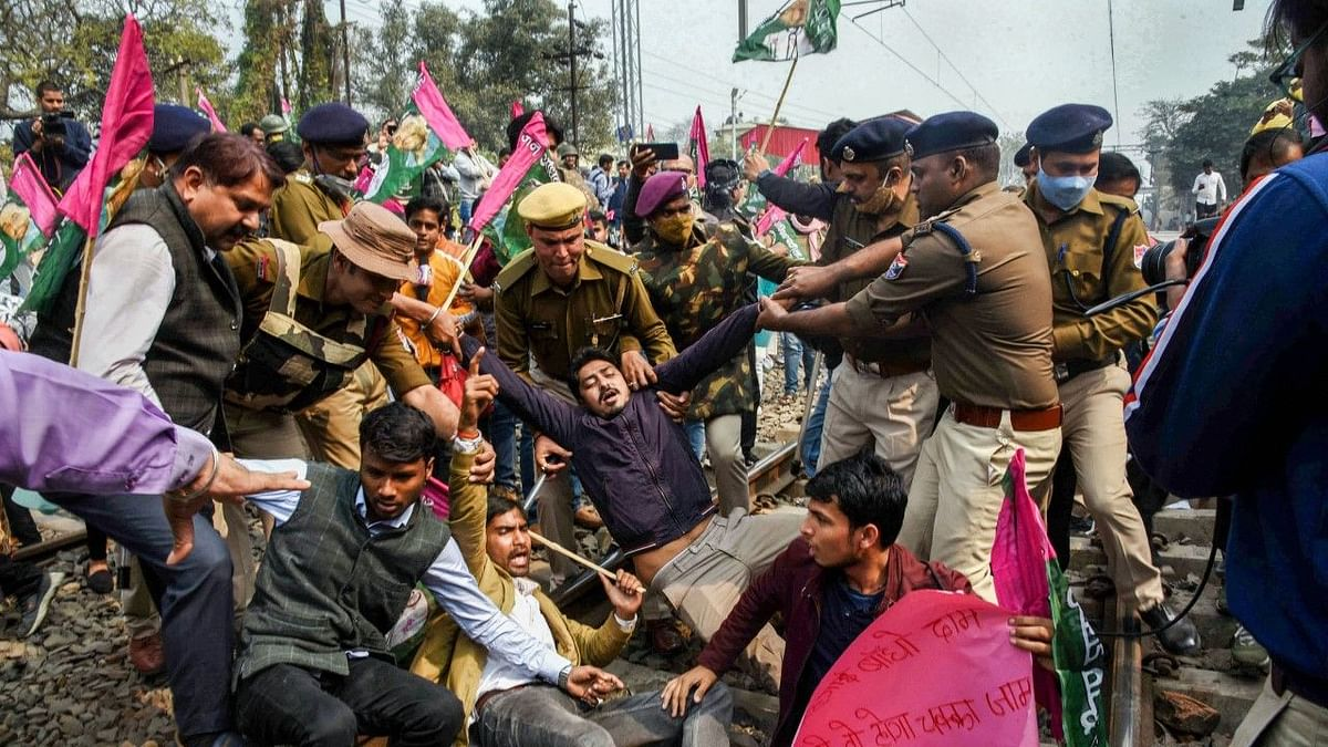 Farmers block a railway track during a four-hour rail roko demonstration across the country, called by Samyukta Kisan Morcha (SKM), as part of their agitation against Centre's farm reform laws, at Rajpura in Patiala district, on 18 February.